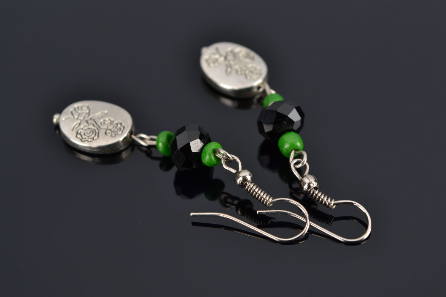 Long earrings with metal charms photo 1
