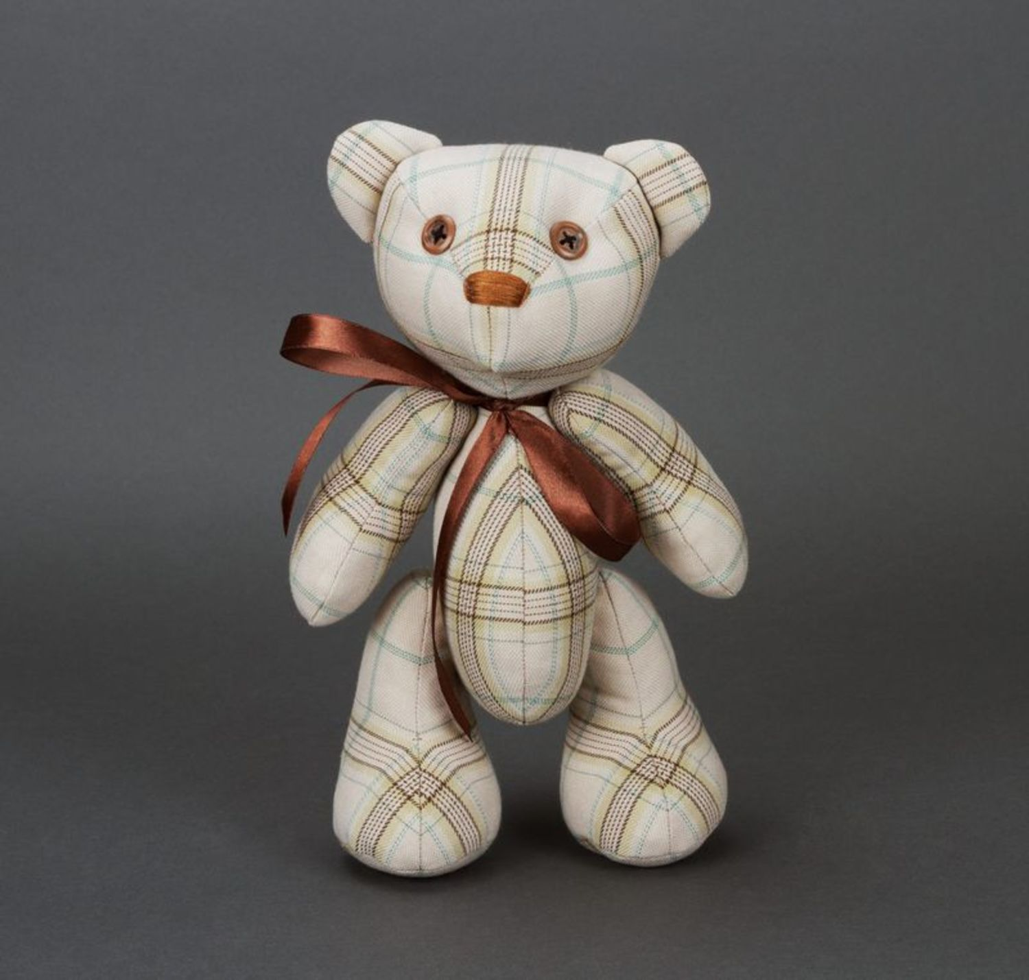 Soft children's toy bear with bow on neck and paws fixed on hinges photo 1