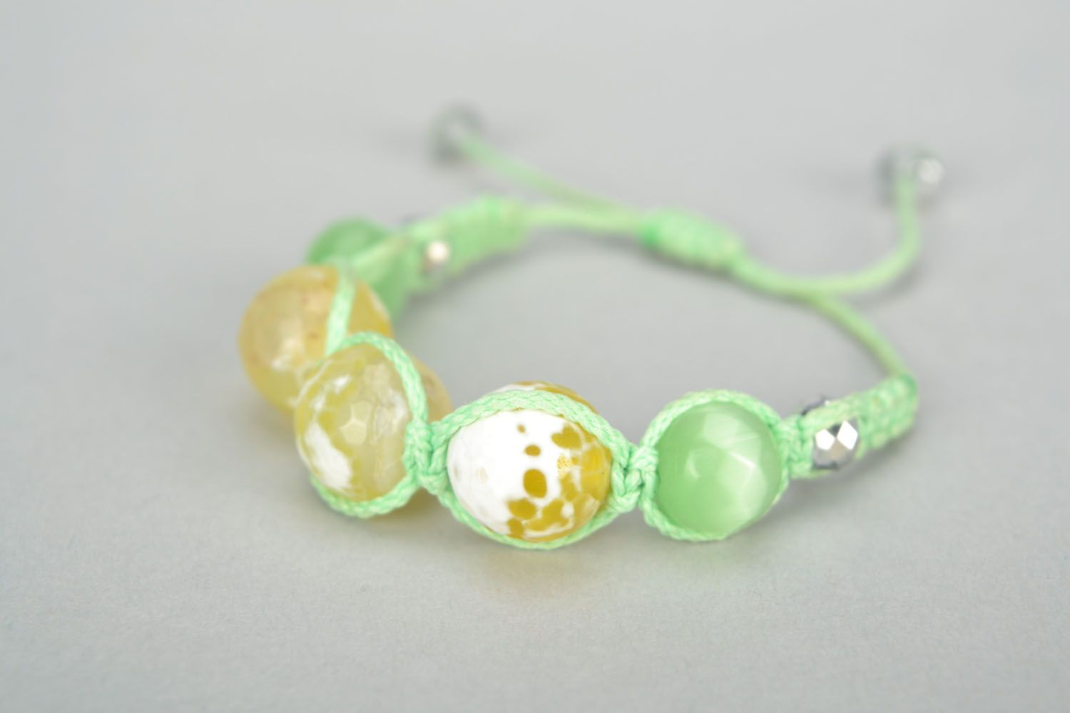 Woven bracelet with cat's eye stone photo 3