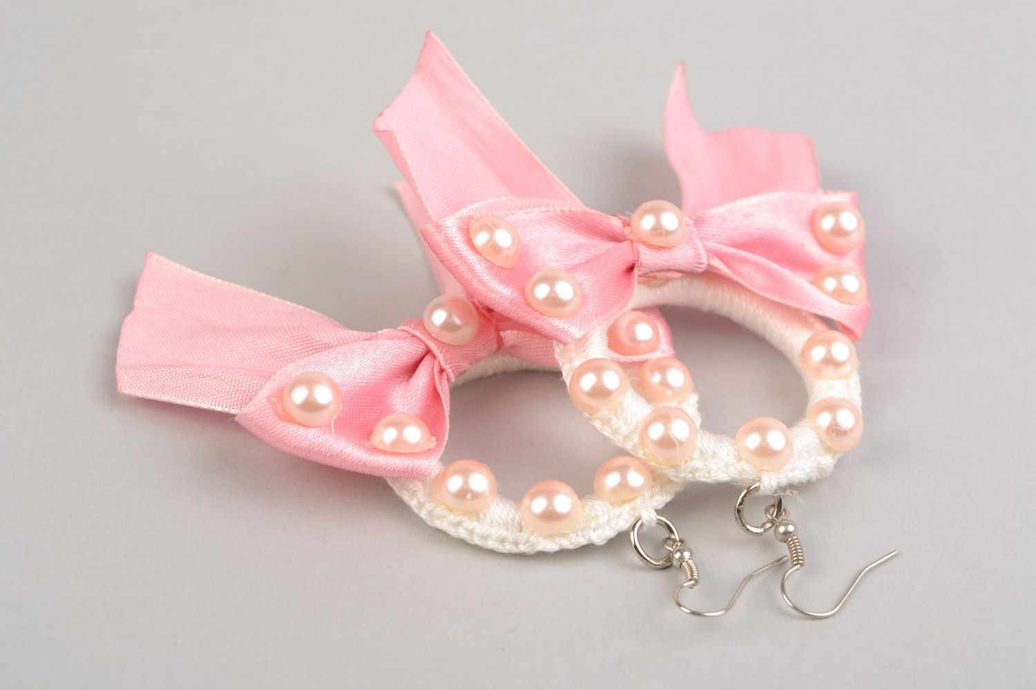 Braided earrings made of plastic rings and threads with pink ribbons present for girlfriend photo 5