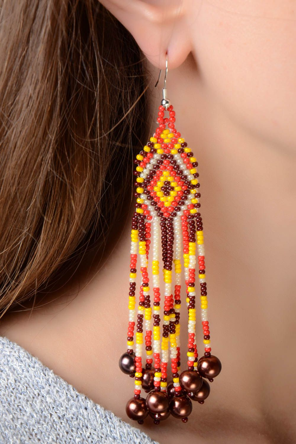 Handmade massive designer long earrings with beaded fringe in ethnic style with hook type ear wires photo 1