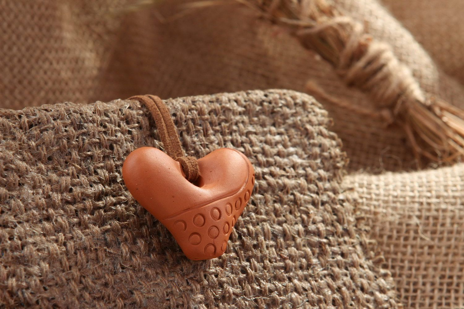 Heart-shaped tin whistle pendant made of clay  photo 1
