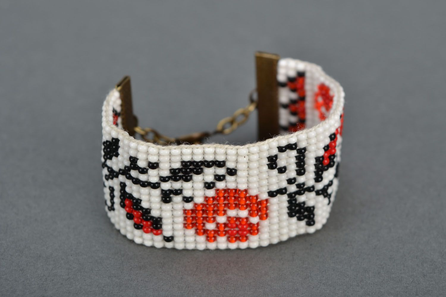 Wide beaded bracelet with ethnic pattern photo 4
