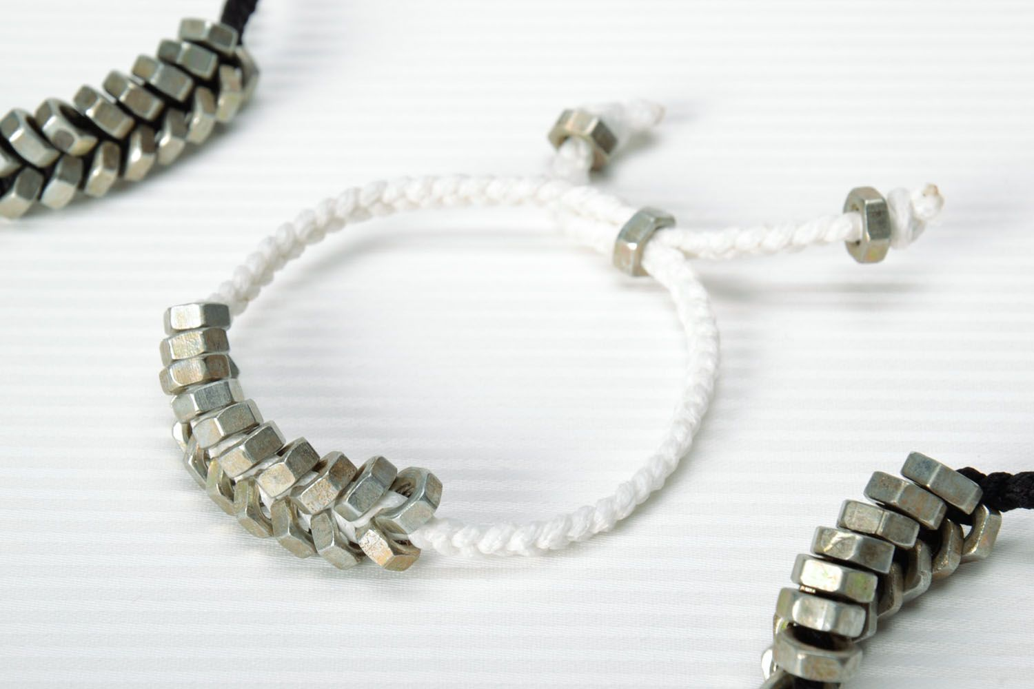 Homemade woven bracelet with metal nuts photo 1