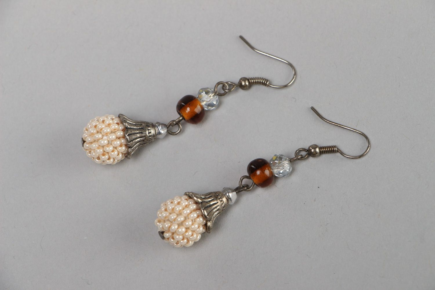 Handmade festive dangle earrings with Czech and glass beads in light color palette photo 1