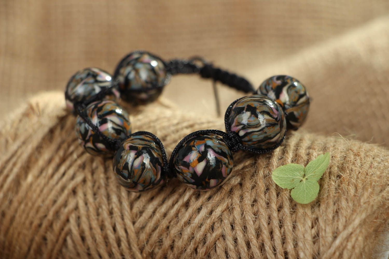 Woven bracelet with polymer clay beads photo 4