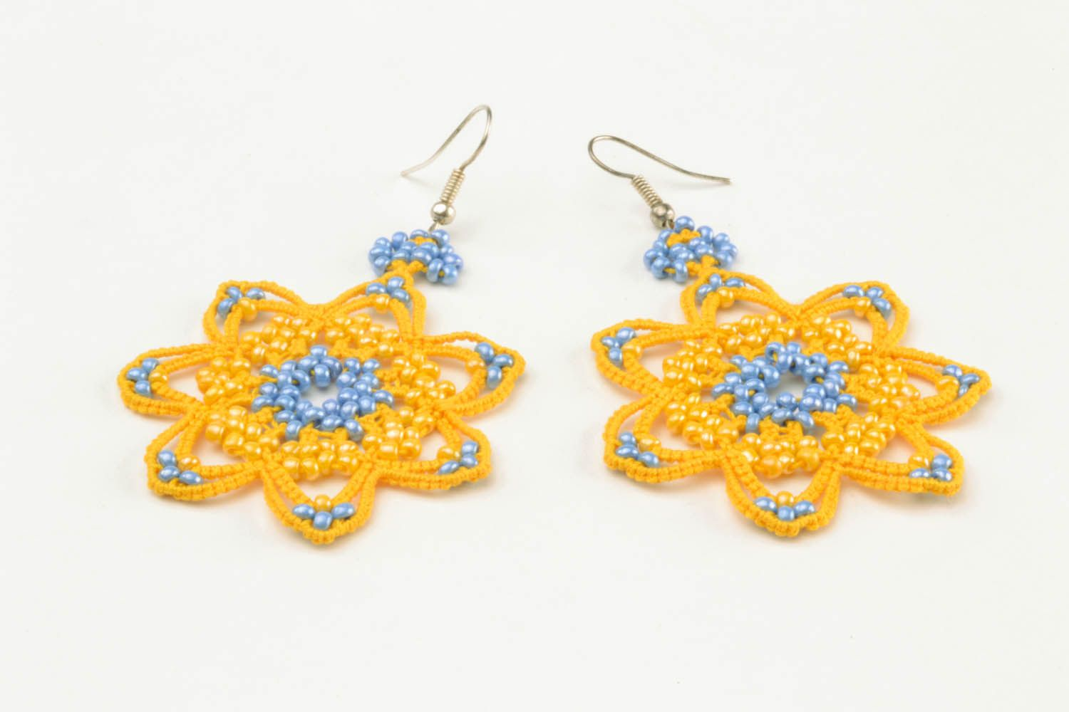 Lace earrings made using tatting technique photo 4