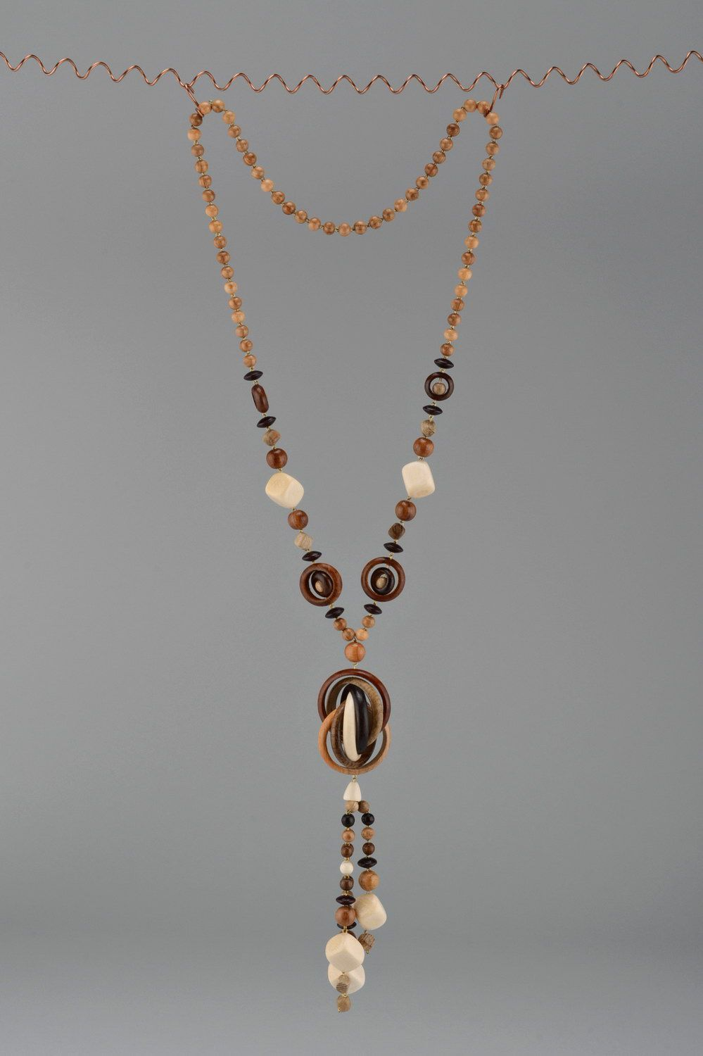 Long beads made of different wood species without clasps photo 3