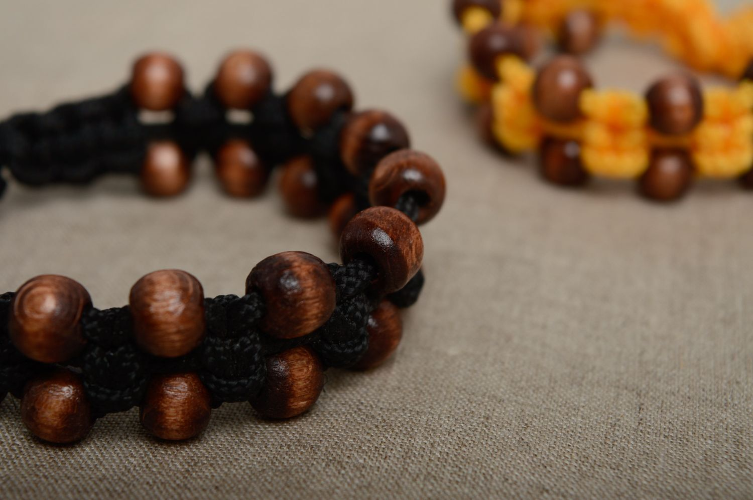 Macrame woven cord bracelet with wooden beads photo 5