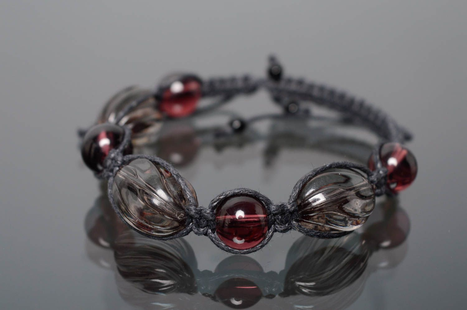 Woven bracelet with beads photo 1