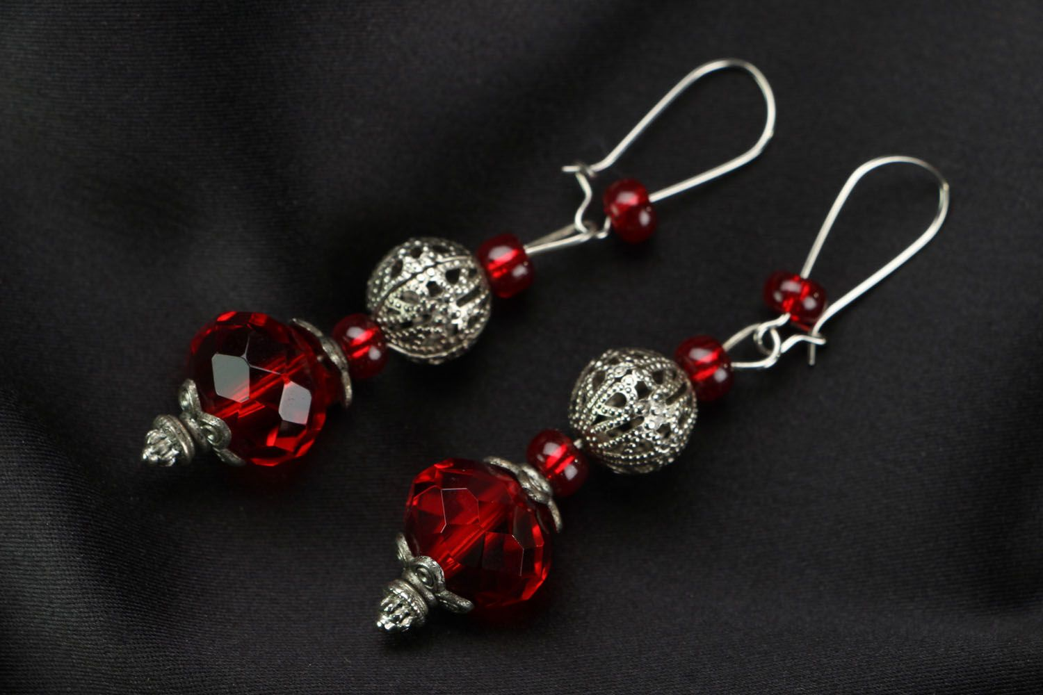 Earrings made of red plastic beads photo 1
