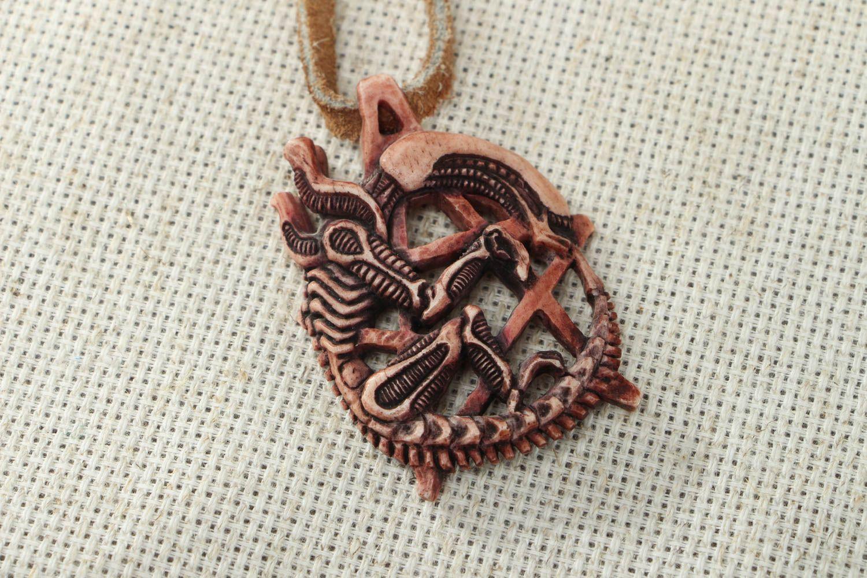 Unusual carved bone pendant photo 4