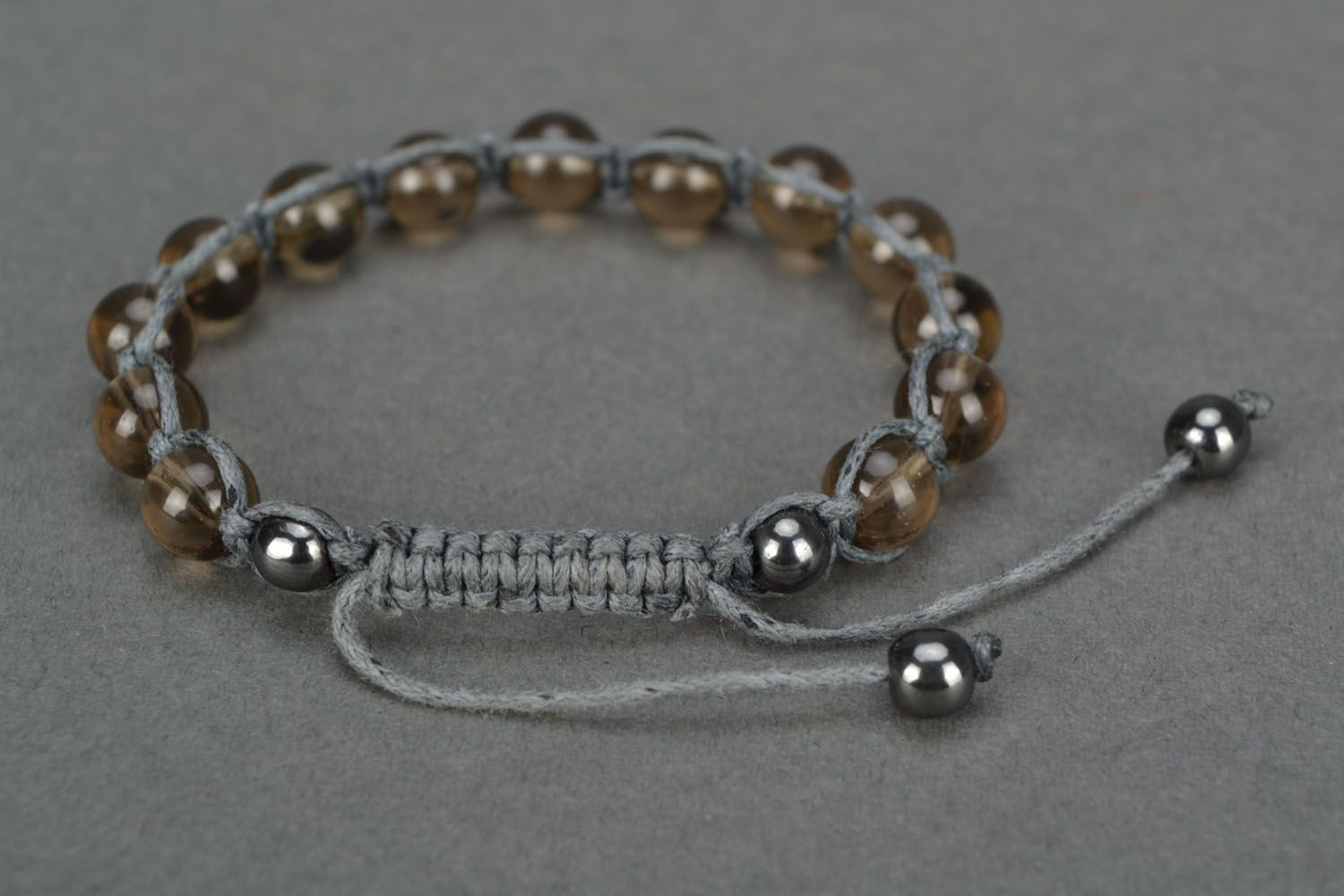Bracelet woven of beads and cord photo 4