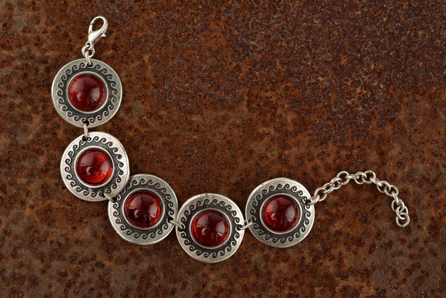 Metal bracelet with red inserts photo 1