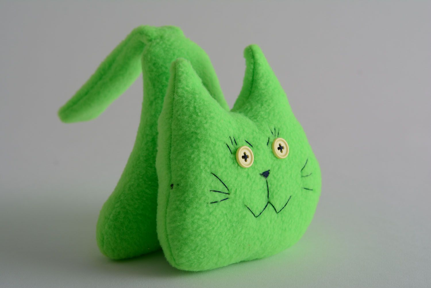 Soft toy in the shape of a green cat photo 1