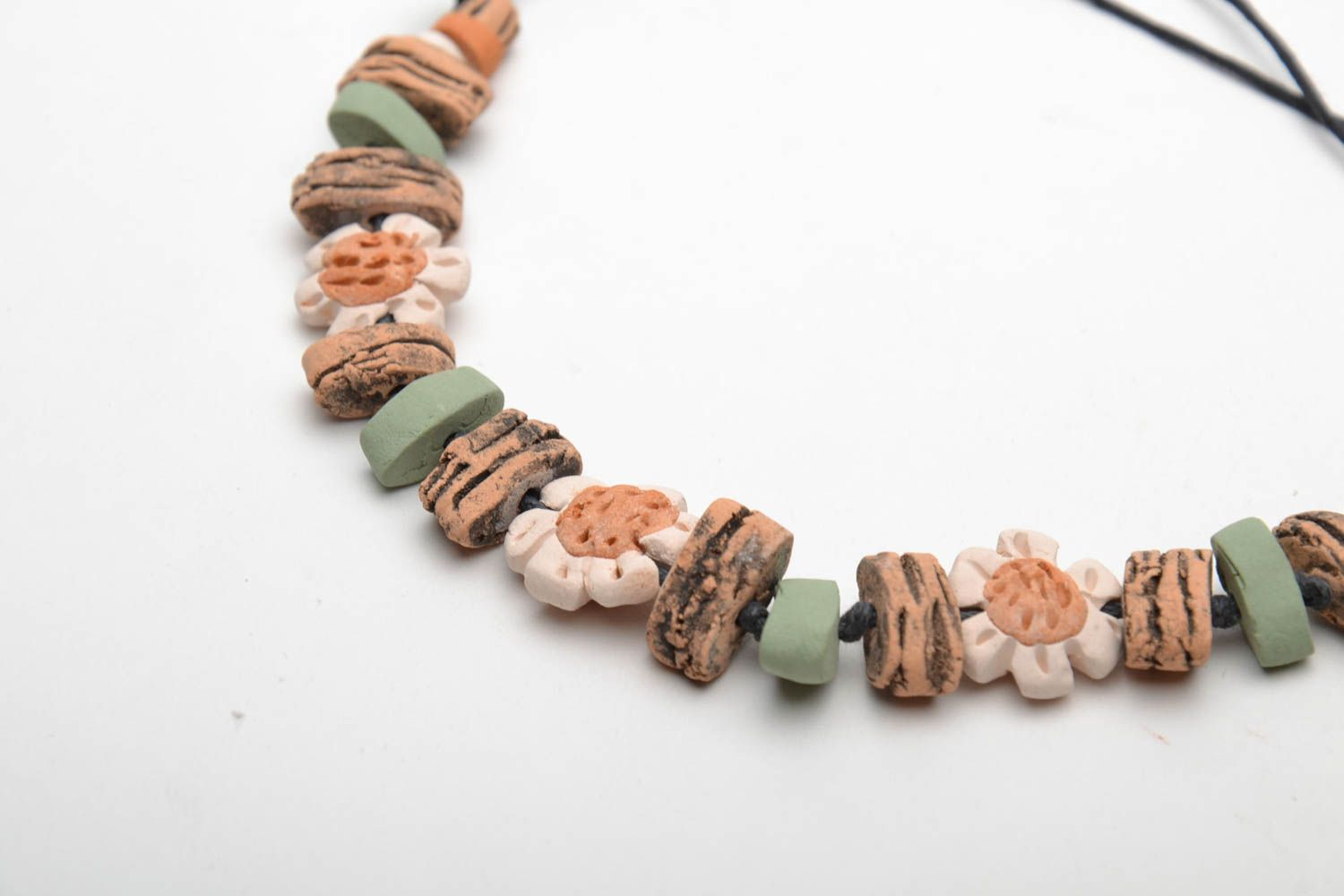 Ceramic bracelet with waxed cord  photo 5