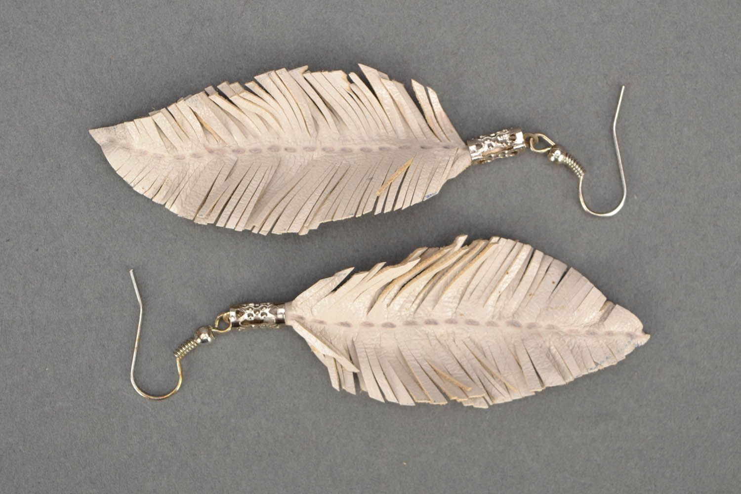 White leather earrings Feathers photo 3