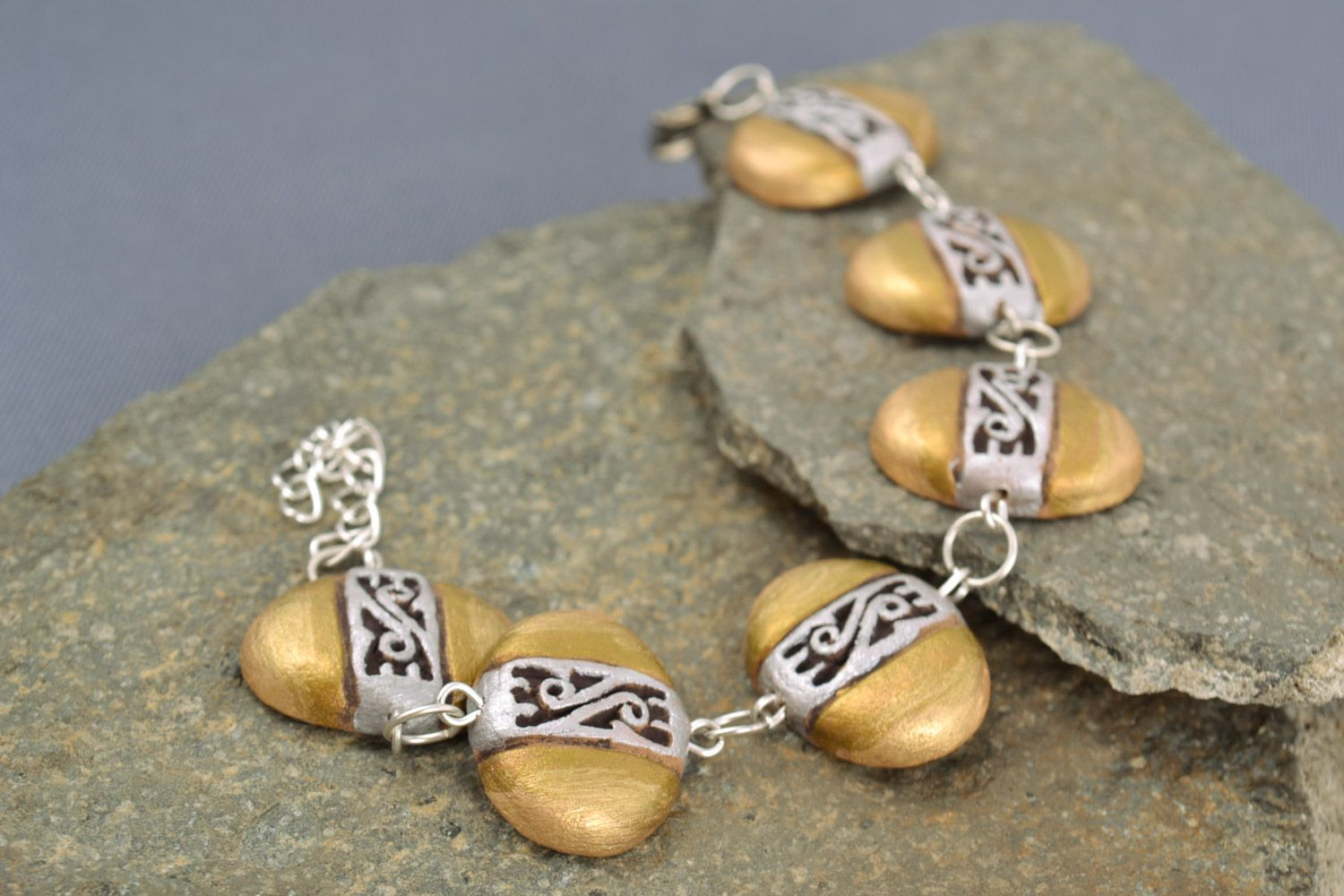 clay bracelets Handmade wrist bracelet on chain with ceramic beads painted with golden acrylics - MADEheart.com