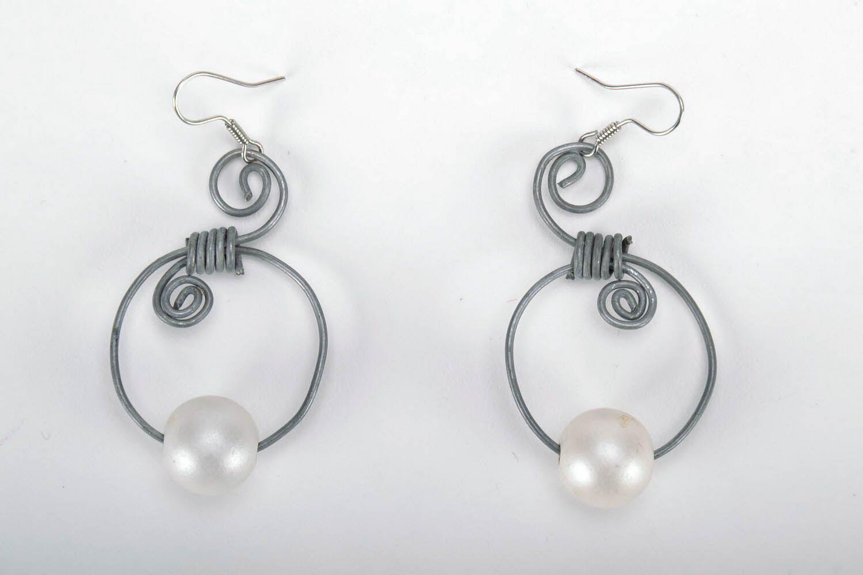 Earrings made of metal photo 3