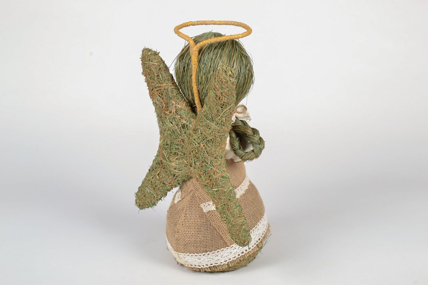 Angel made of grass and hay photo 2