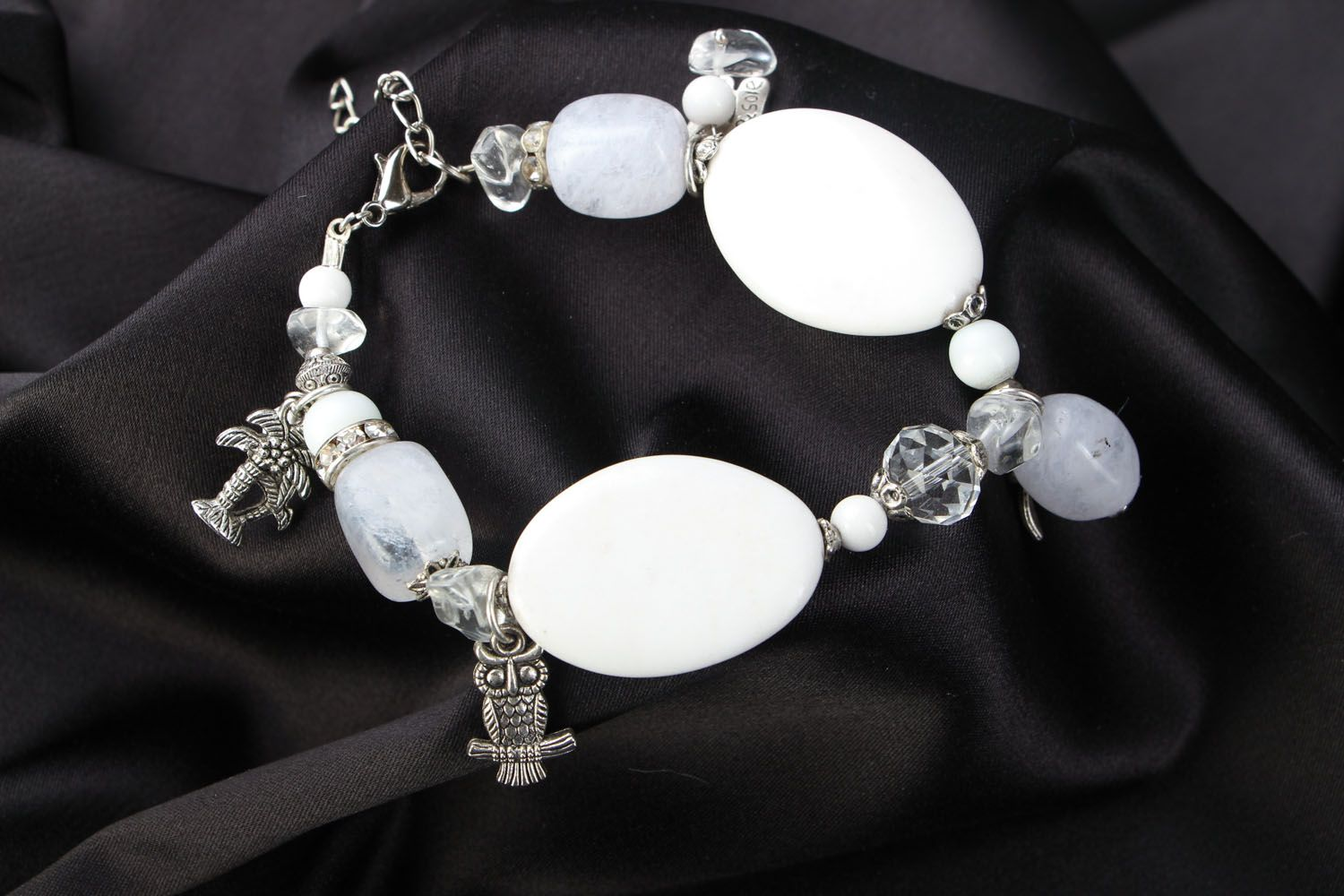Natural stone bracelet with charms photo 1