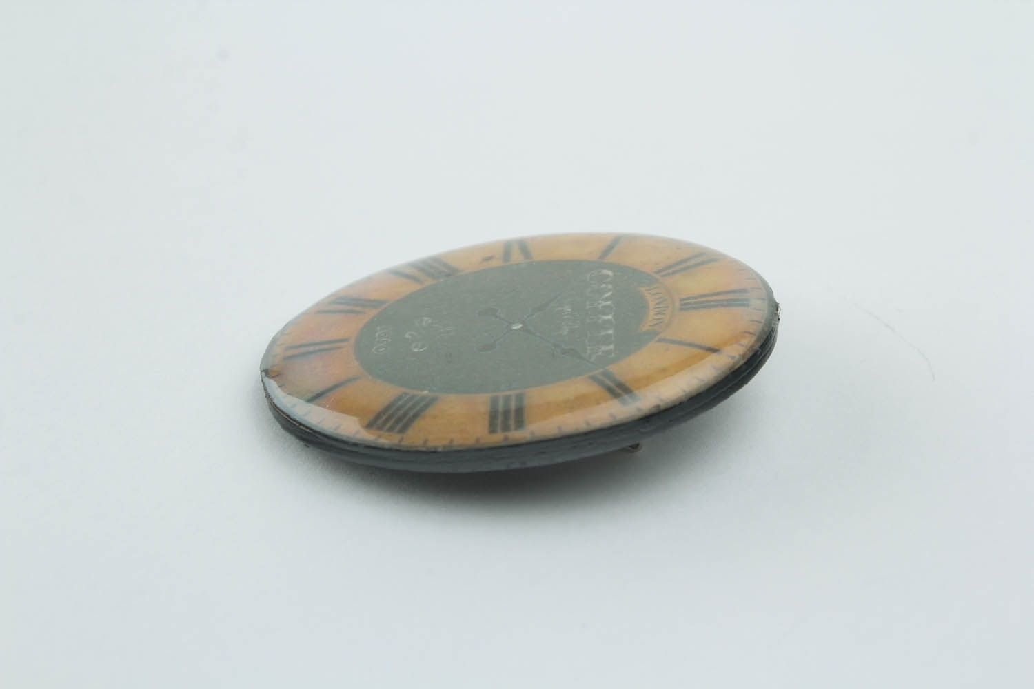 Round brooch made ​​of polymer clay photo 3