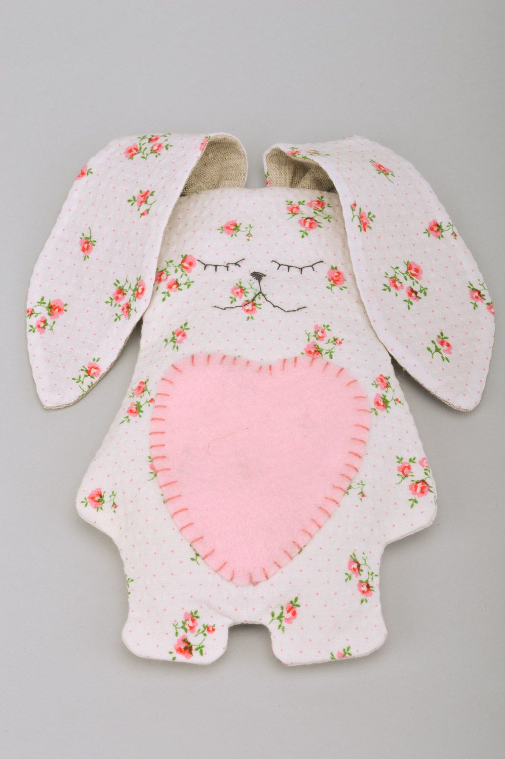 Handmade soft toy rabbit with long ears sewn of cotton fabric with floral print photo 1