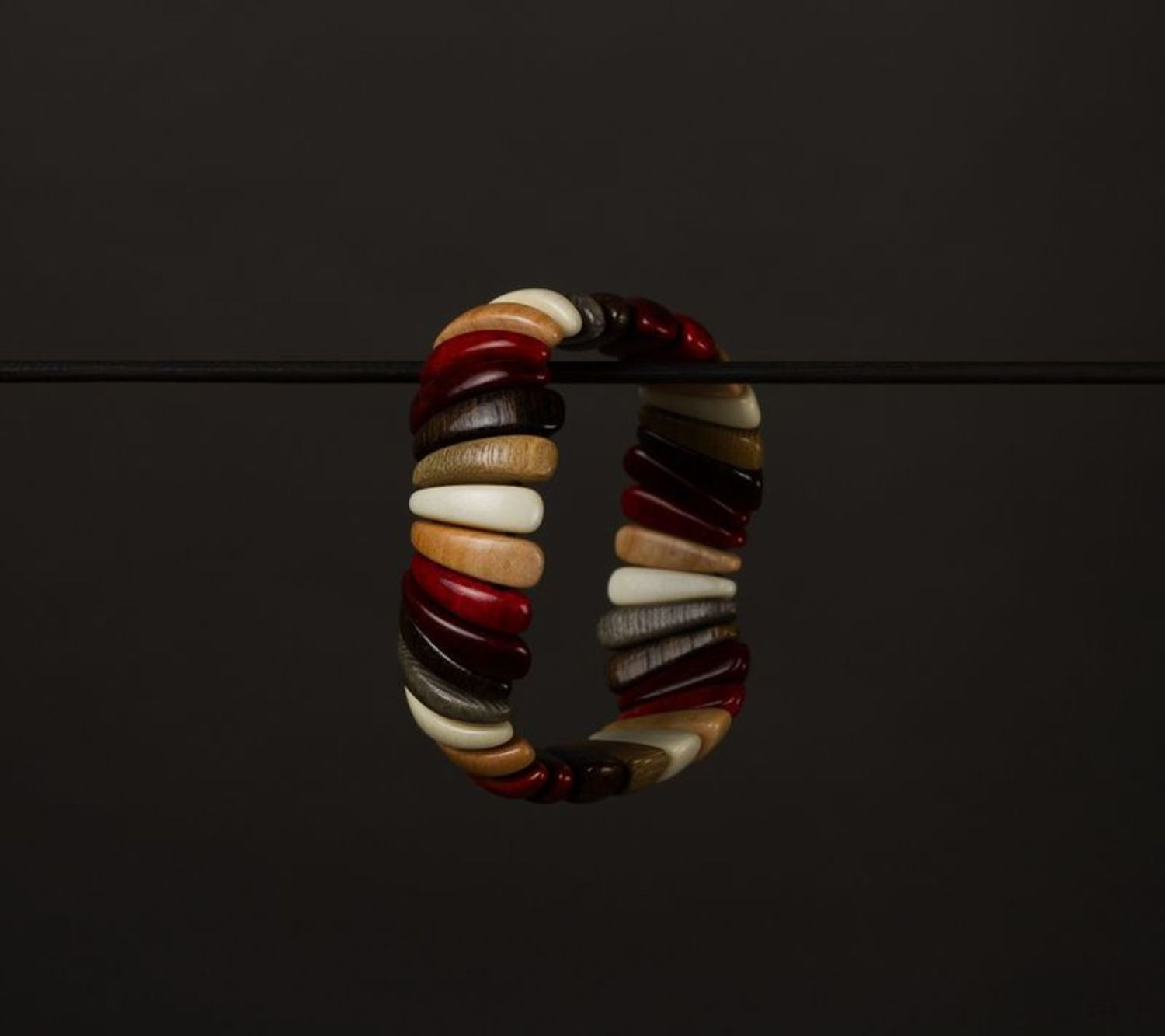 Wooden bracelet on elastic band photo 1