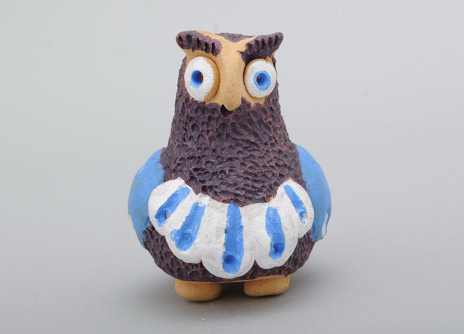 Penny whistle in the form of owl made of clay photo 3