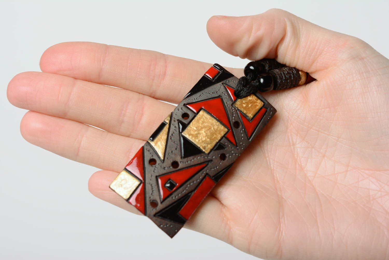 pendants Handcrafted ceramic pendant made of clay with colored enamel paintings - MADEheart.com