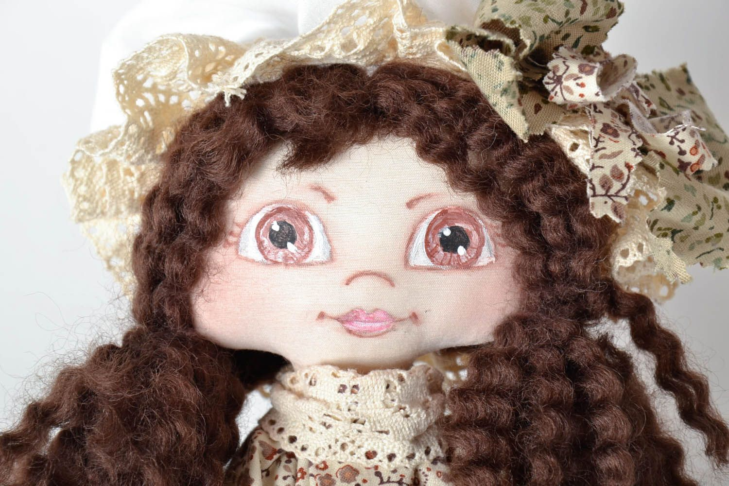 Decorative doll in a hat photo 4