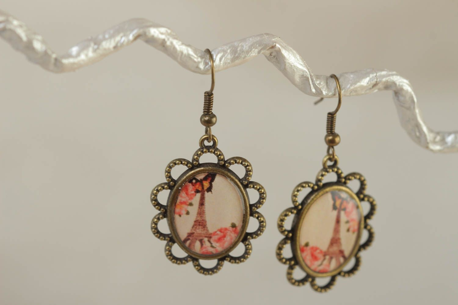 Handmade vintage oval earrings made of metal and glass glaze with a print of Eiffel tower photo 1