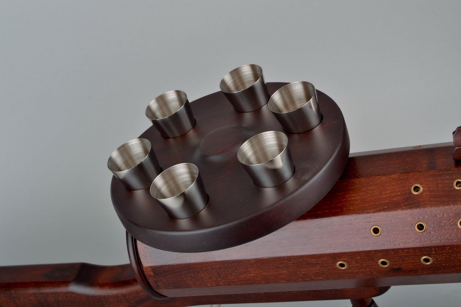 Wooden wine bottle stand in the form of a gun photo 3