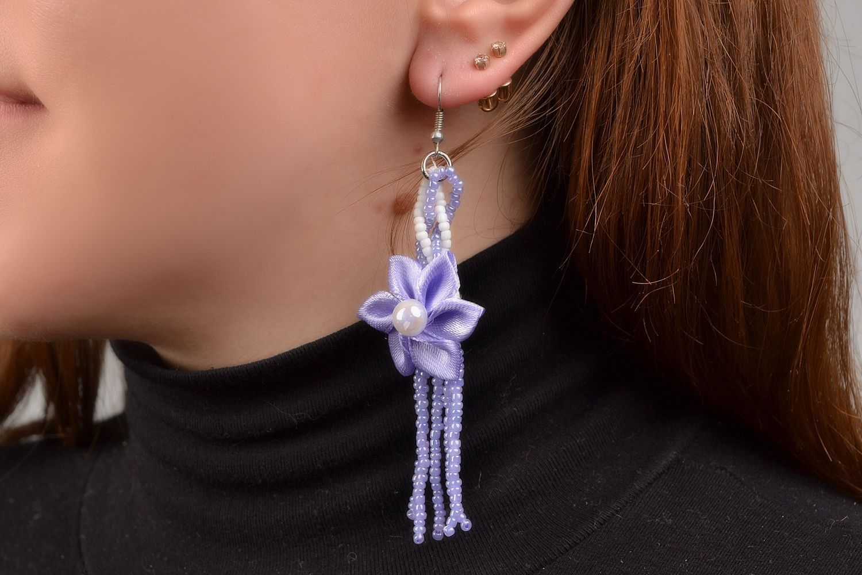 Braided handmade long purple earrings made of satin with flower photo 1