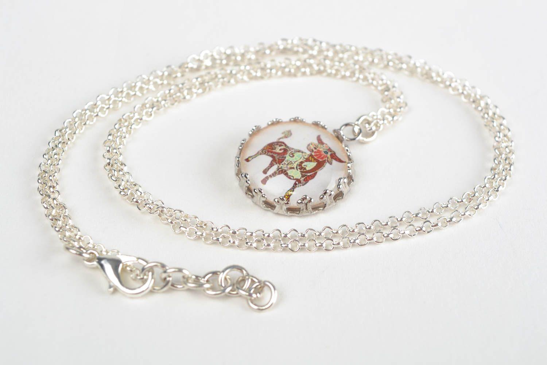 Handmade designer round white glass pendant on chain with image of Taurus photo 1
