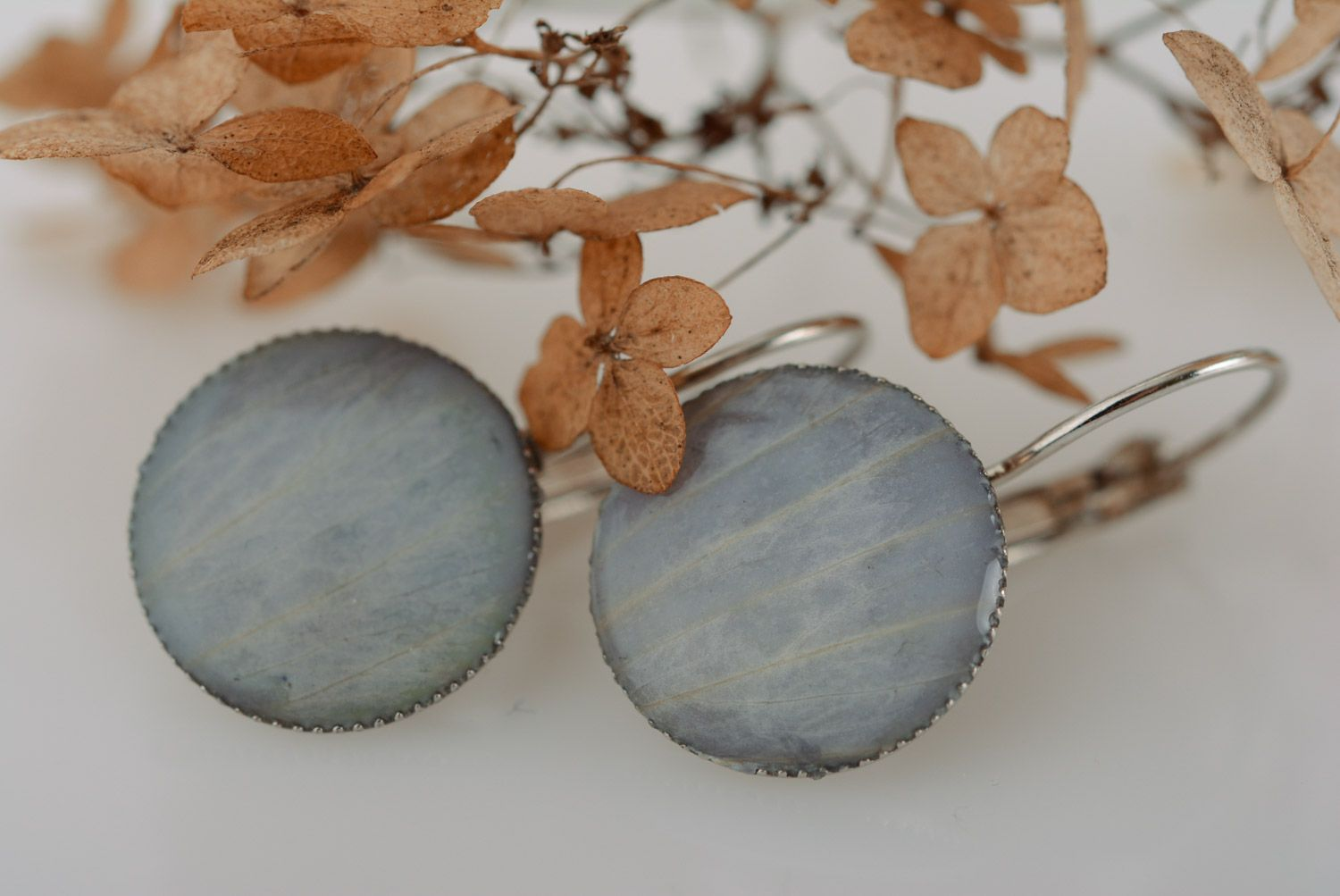 Handmade designer round earrings with flower petals coated with epoxy photo 1