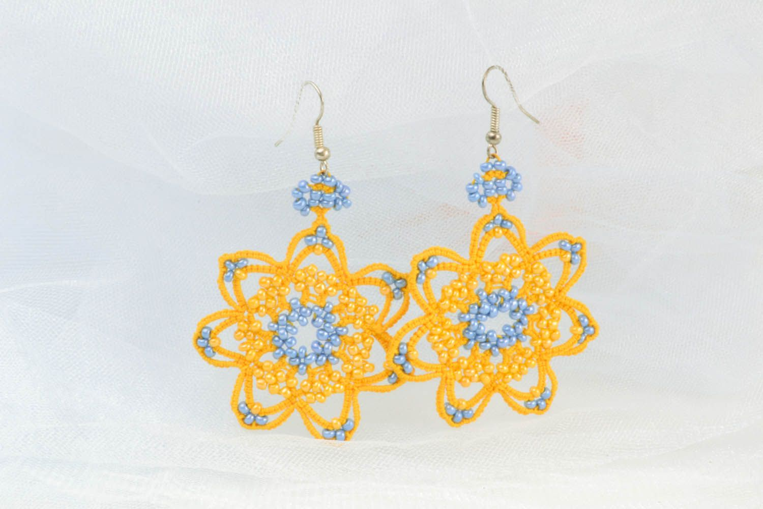 Lace earrings made using tatting technique photo 1