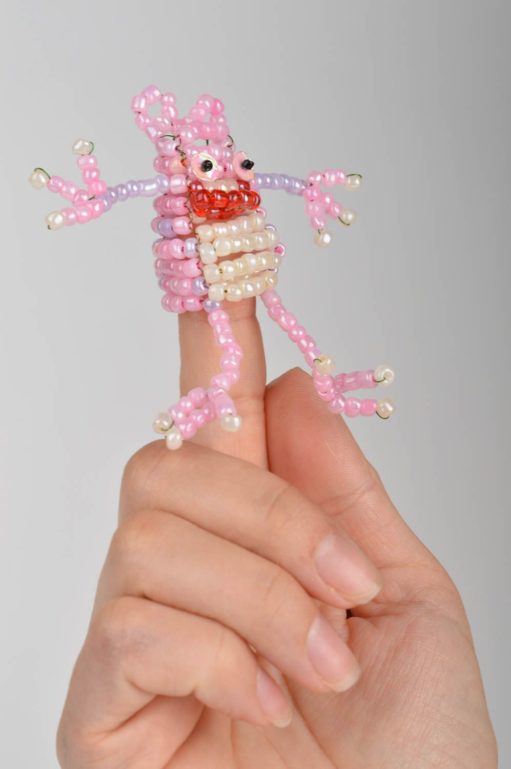 Notice: Undefined variable: cat in /home/newmadeheart/prod/cache/volt/%%home%%newmadeheart%%prod%%app%%views%%product%%index.volt.php on line 139  Handmade cute pink funny toy for finger in shape of frog made of beads - MADEheart.com