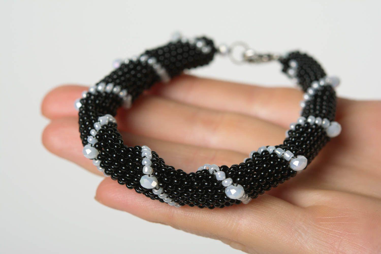 Handmade beaded cord wrist bracelet of white and black colors for women photo 4
