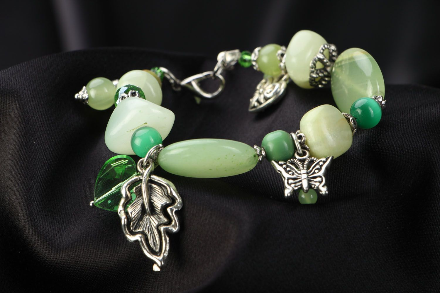 Handmade bracelet with metal charms photo 2