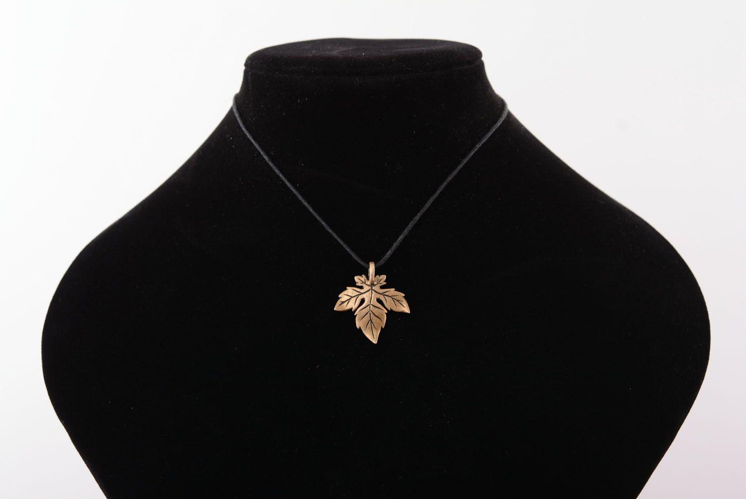 Bronze pendant in the shape of a leaf photo 5
