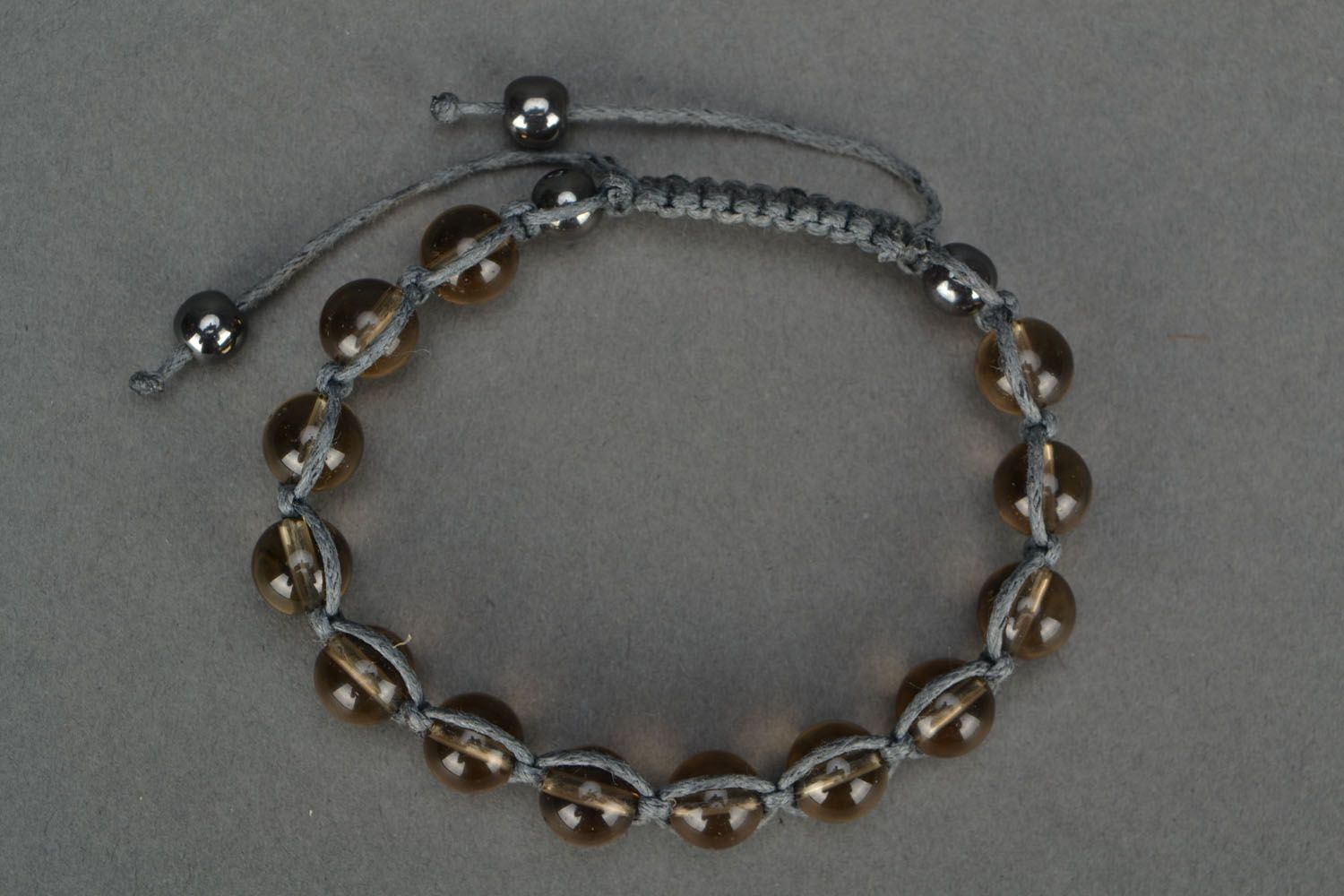 Bracelet woven of beads and cord photo 2