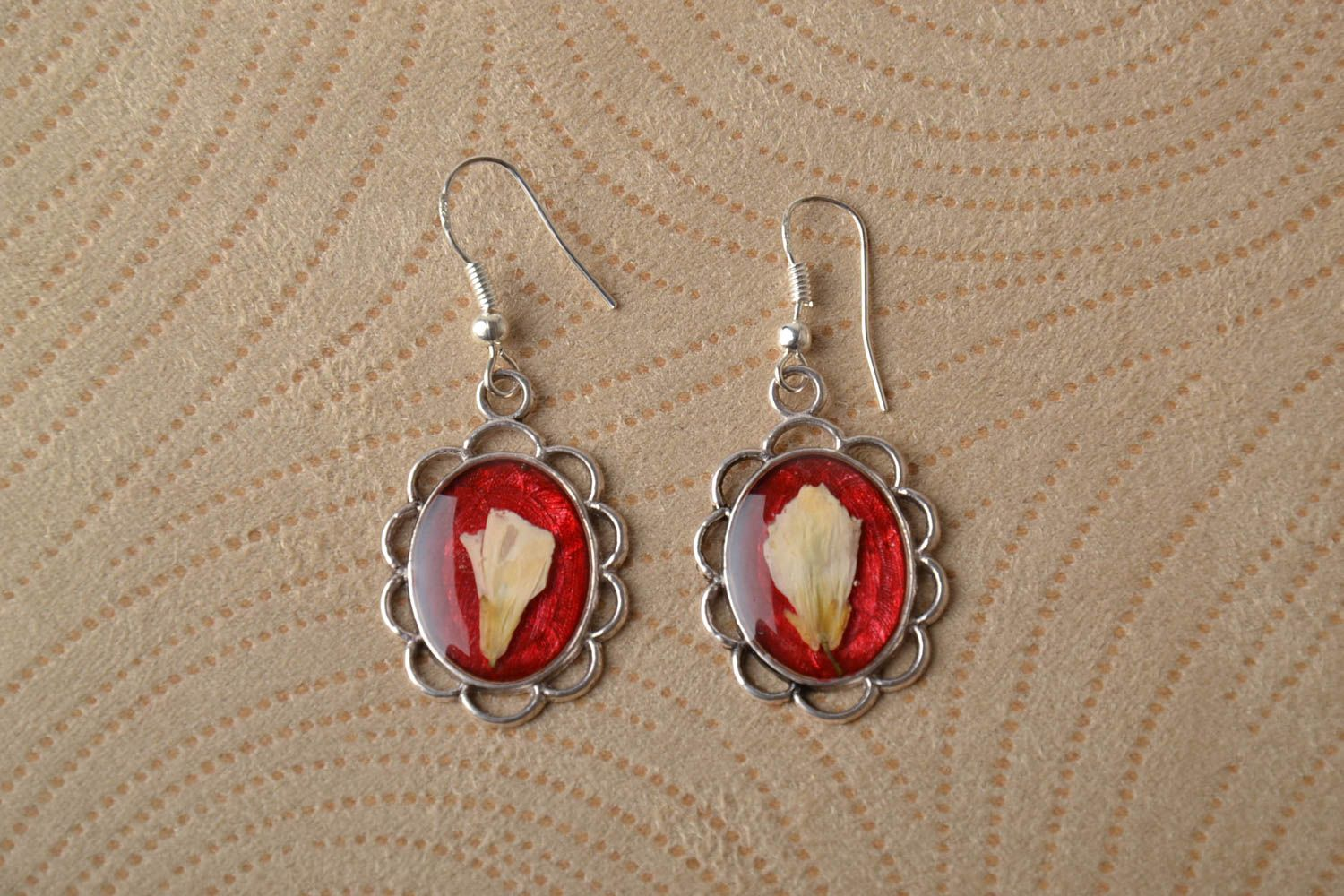 Red earrings with natural flowers and epoxy resin photo 1