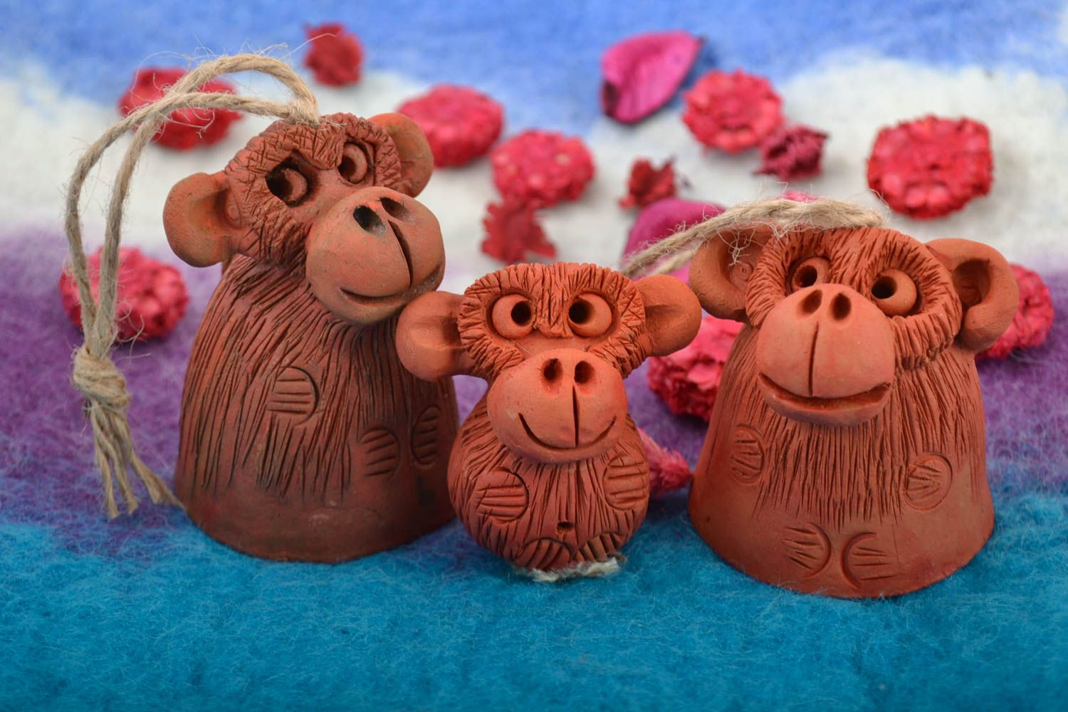 Set of handmade ceramic bells and figurine in the form of monkeys for home decor photo 1