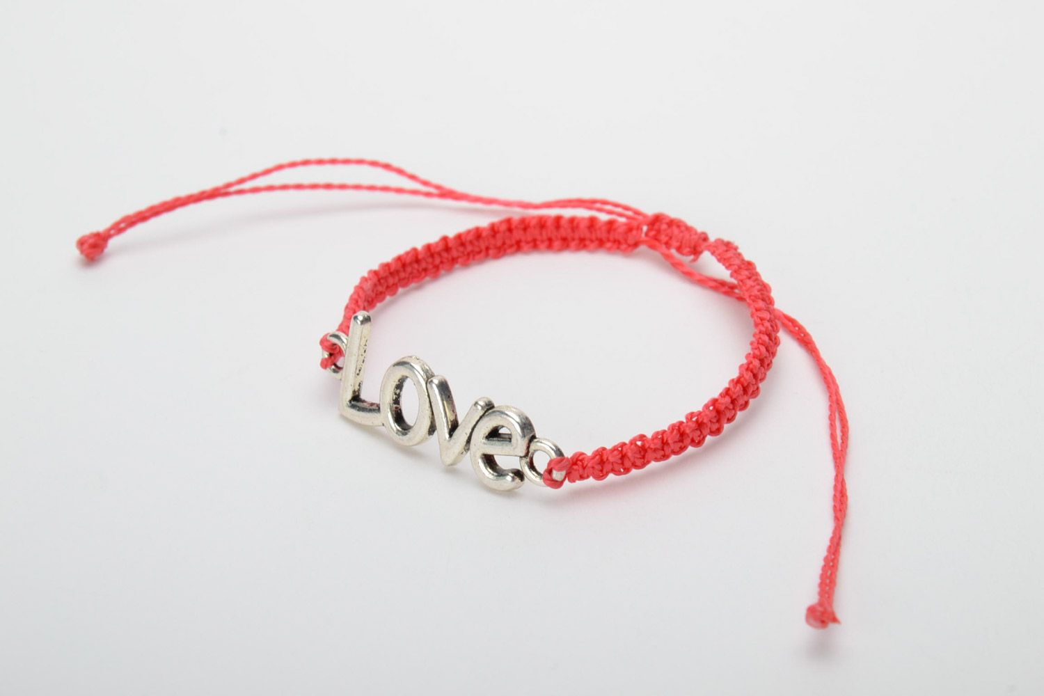 Handmade women's woven cord bracelet of red color with metal charm lettering photo 3