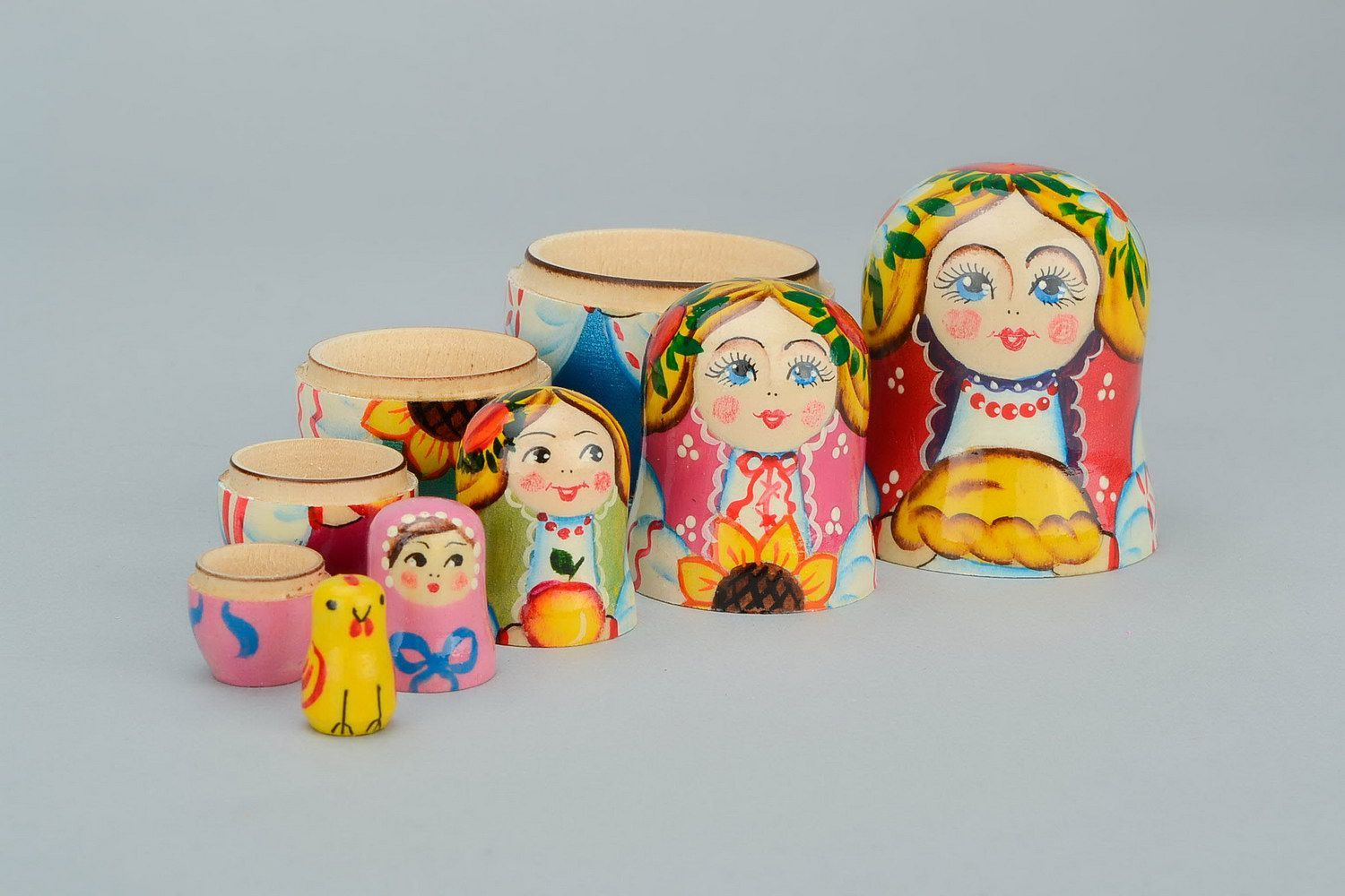 Wooden matryoshka doll with loaf photo 4