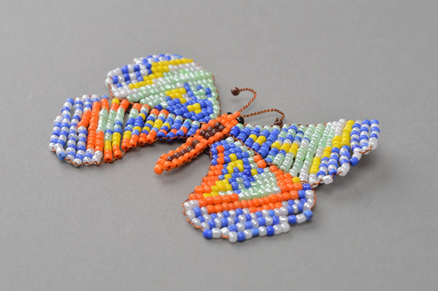 Unusual handmade woven magnet-butterfly on the fridge made of beads photo 3