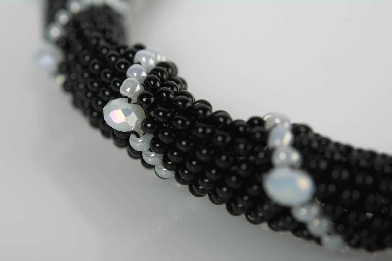 Handmade beaded cord wrist bracelet of white and black colors for women photo 2