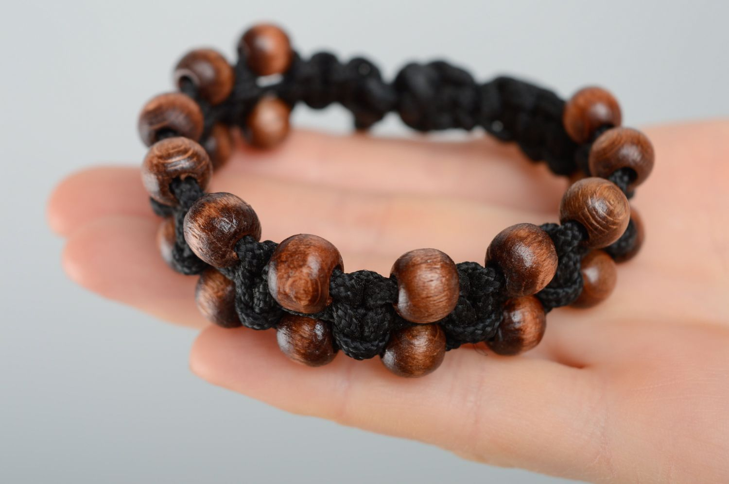 Macrame woven cord bracelet with wooden beads photo 3