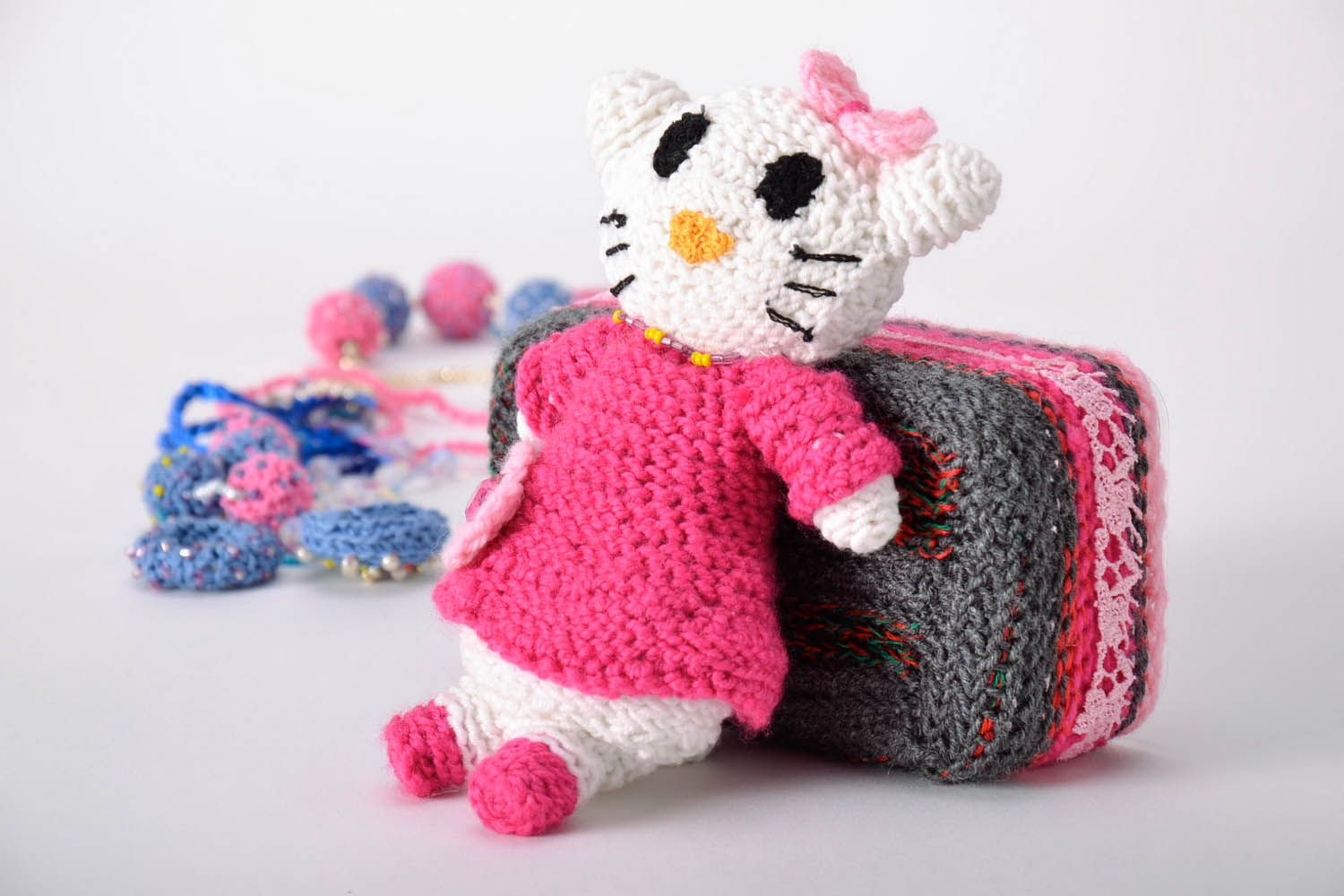Toy crocheted around with wool threads photo 1